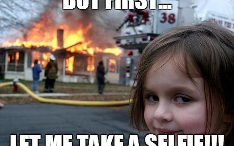 Disaster meme girl selfie