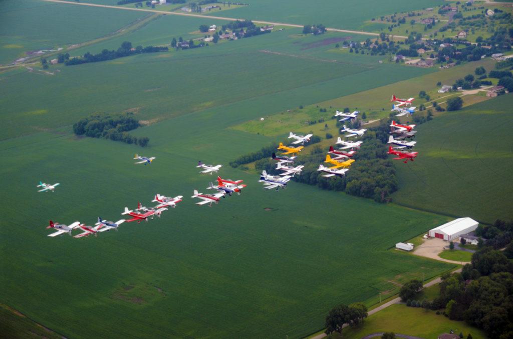 Vans RVs in formation, planes