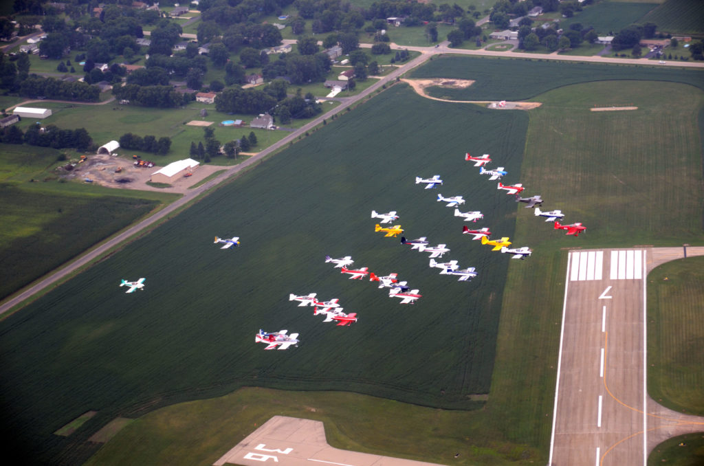 RVs flying in formation over airport