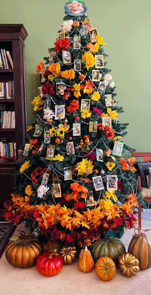 Christmas tree decorated with squirrels and fall flowers